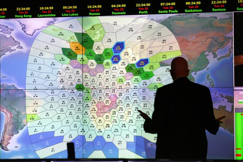 File photo shows a staff memeber at satellite communications company Inmarsat working in front of a screen showing subscribers using their service throughout the world, at their headquarters in London March 25, 2014. — Reuters pic