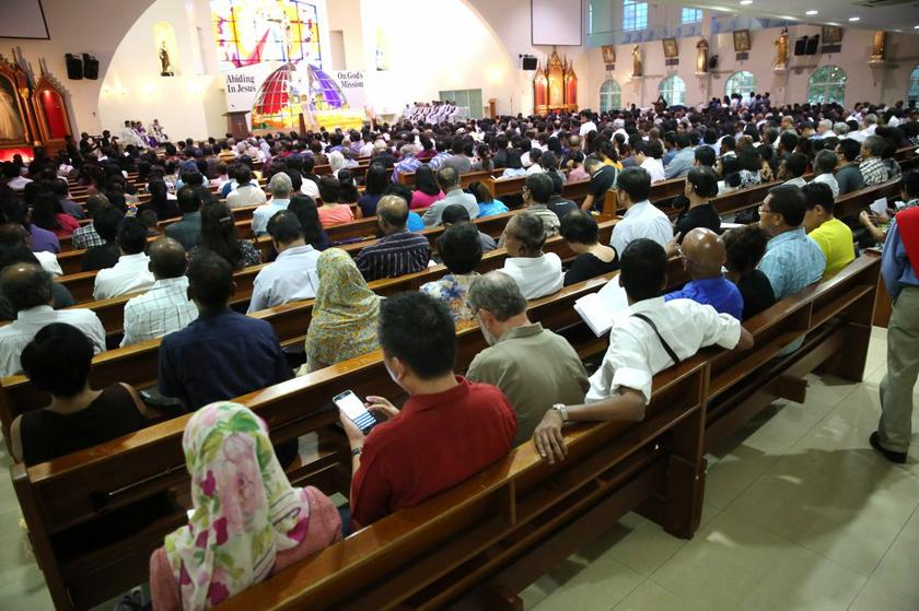 Mourners attend the funeral of Irene Fernandez at the Divine Mercy Church, in Shah Alam, on April 3, 2014. — Pictures by Choo Choy May