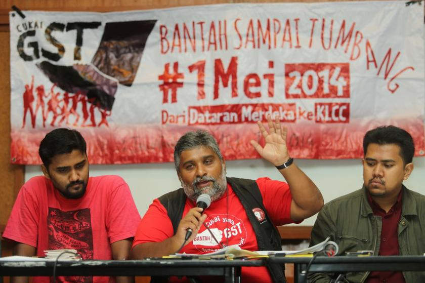 Members of the May 1 Committee at a press conference stating that the anti-GST rally will proceed on May Day despite the police ban, on April 25, 2014. — Picture by Choo Choy May