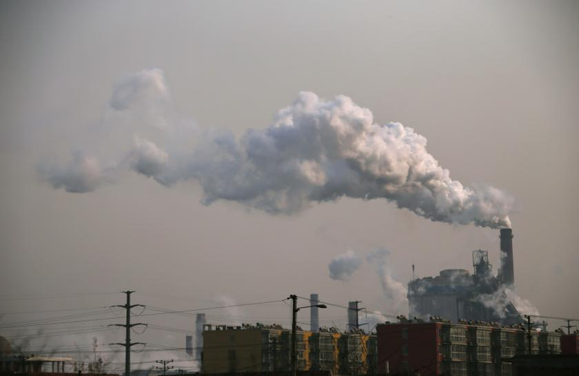 Smoke rises from a chimney of a steel plant next to residential buildings on a hazy day in Fengnan district of Tangshan, Hebei province in this February 18, 2014 file photo. — Reuters pic