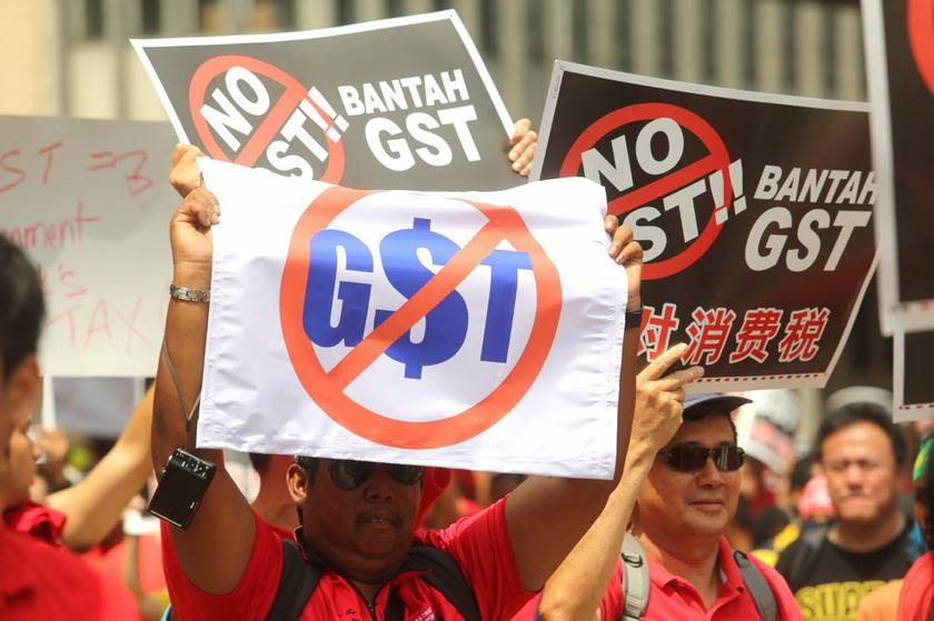 Protesters holding up placards during the protest against the Goods and Services Tax. — File picture by Choo Choy May
