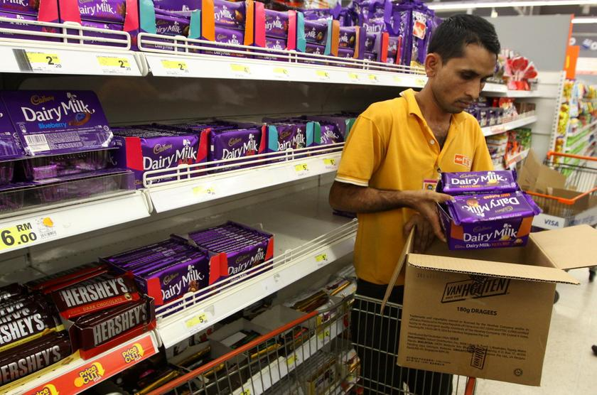 A staff removes packages of Cadbury Dairy Milk Hazelnut that have been confirmed to contain traces of pig DNA from a shelf at a local supermarket, Kuala Lumpur, May 24, 2014. — Bernama pic