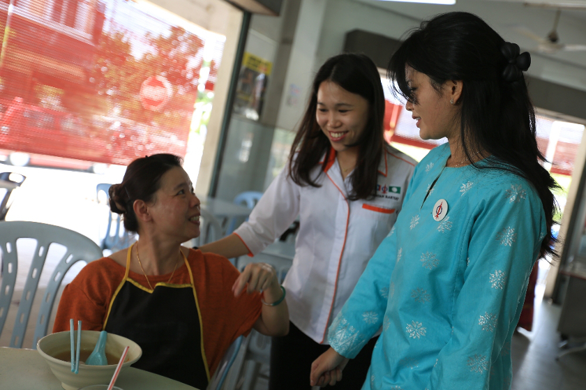 DAP's candidate Dyana Sofya Mohd Daud (right) greets residents during a walkabout session in Teluk Intan, on May 19, 2014. — Picture by Saw Siow Feng