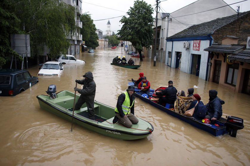 People evacuate in boats in the flooded town of Obrenovac, east from Belgrade, May 17, 2014. ― Reuters pic