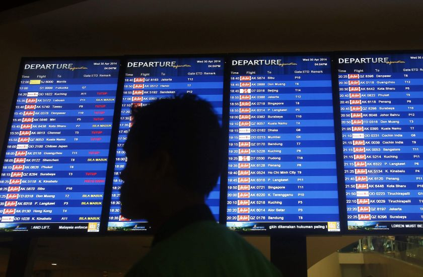 File picture of a man walking in front of a flight board at KLIA2 in Sepang April 30, 2014. Matta president Datuk Hamzah Rahmat said that people using low-cost terminal KLIA 2 looked for budget travelling and would welcome removal of the airport tax. — Reuters pic