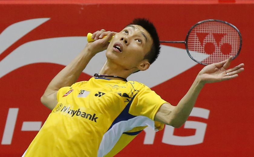 Lee Chong Wei returns a shot to Indonesia's Tommy Sugiarto during their men's singles semi-final match at the Thomas Cup badminton championship in New Delhi May 23, 2014. — Reuters pic