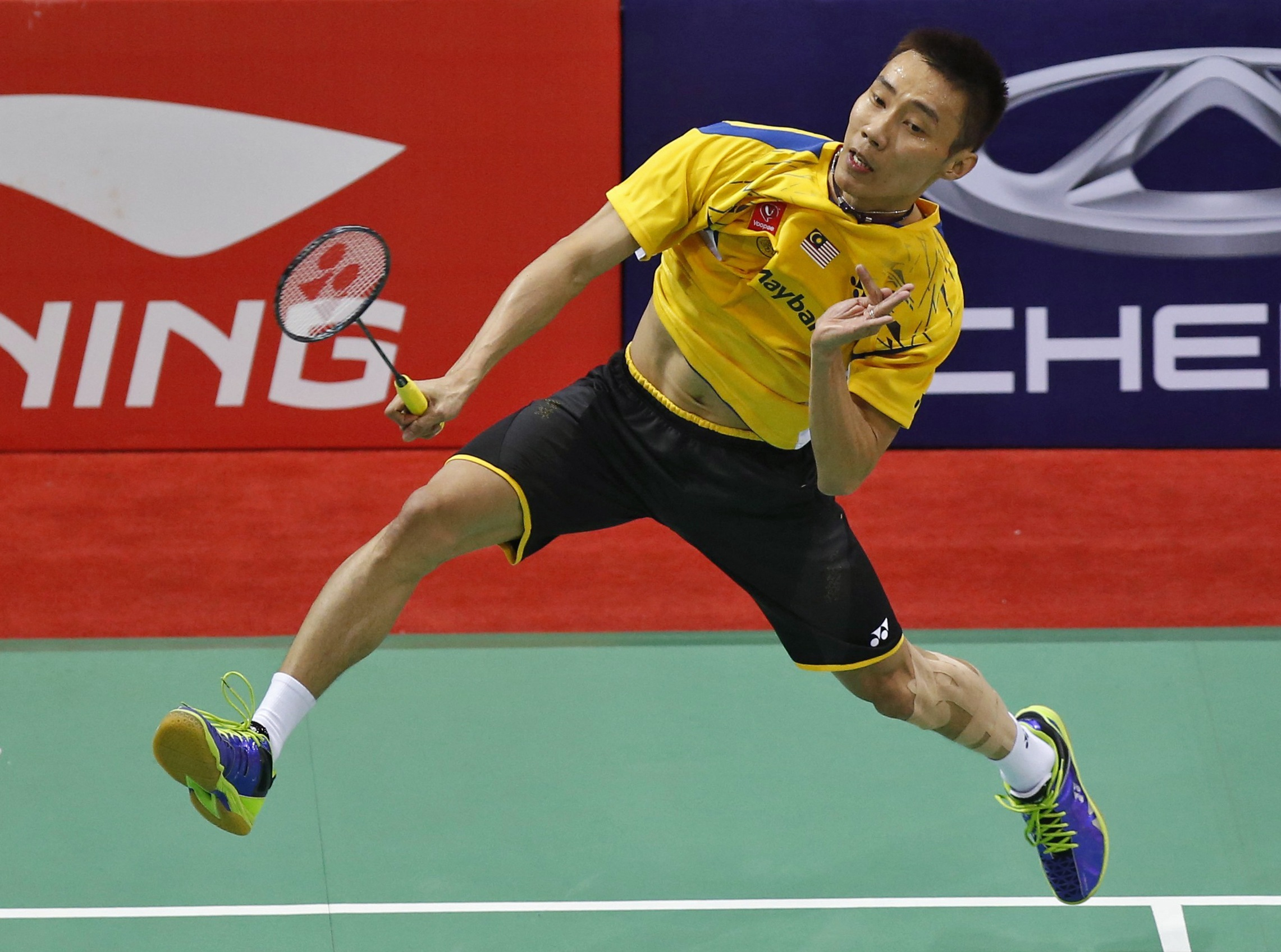 Malaysia's Lee Chong Wei prepares to return a shot to South Korea's Son Wan-ho during their men's singles match in the Thomas Cup badminton championship in New Delhi May 21, 2014. — Reuters pic