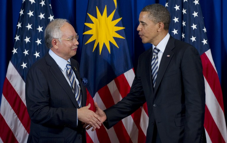 Researchers said the strength of a handshake grip may reveal aging rate and education level. File photo shows US President Barack Obama shaking hands with Prime Minister Datuk Seri Najib Tun Razak in Bali, November 18, 2011.  — AFP pic