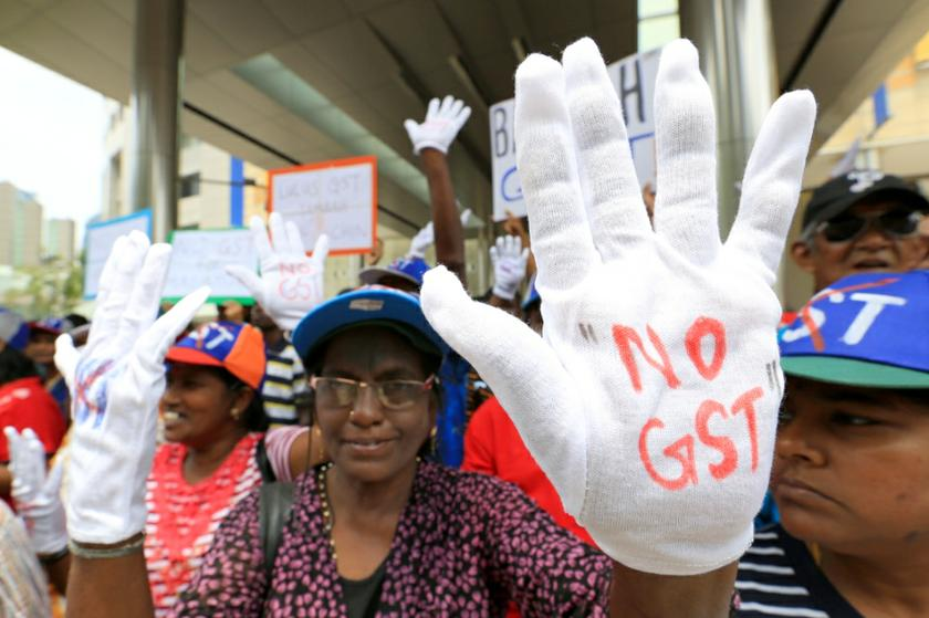 Crowds have gathered at various locations in Kuala Lumpur by noon before converging at Dataran Merdeka for an anti-GST rally, May 1, 2014. — Picture by Saw Siow Feng