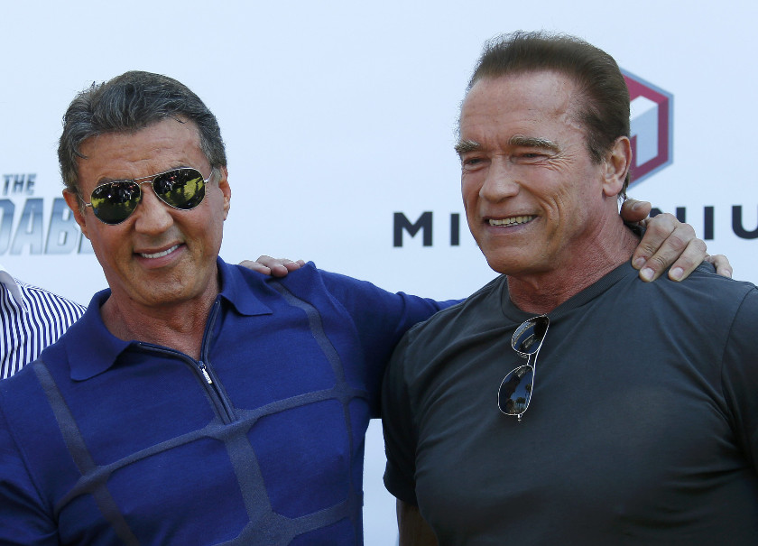 Actors Sylvester Stallone (left) and Arnold Schwarzenegger star in 'The Expendables 3'. — Reuters pic