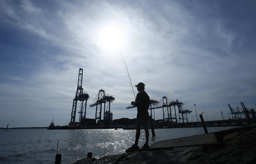 File picture shows a man being silhouetted as he fishes near Northport in Klang June 7, 2014. — Reuters pic