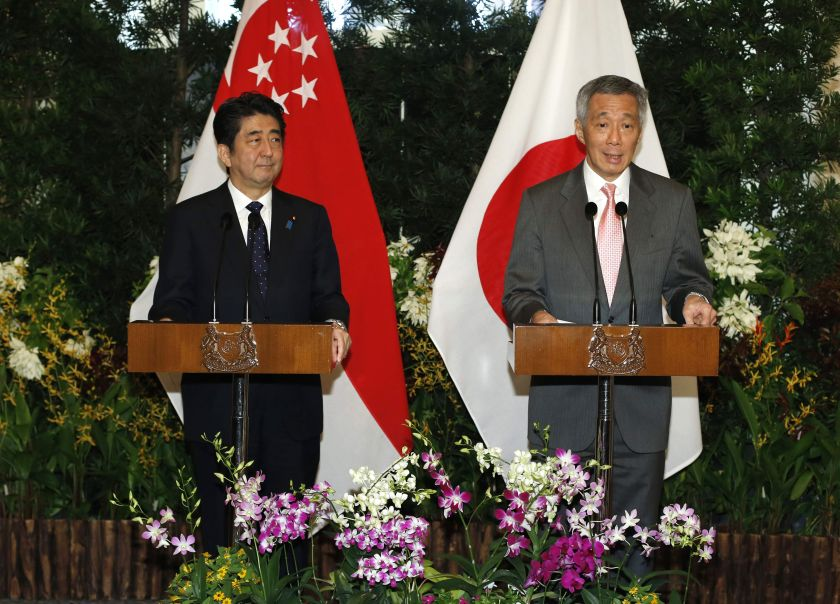 Japan's Prime Minister Shinzo Abe and Singapore's Prime Minister Lee Hsien Loong (right) speak at a news conference after a meeting at the Istana in Singapore, May 31, 2014. — Reuters pic
