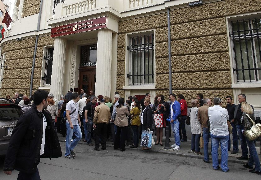 People queue outside the main office of Corpbank. — Reuters pic