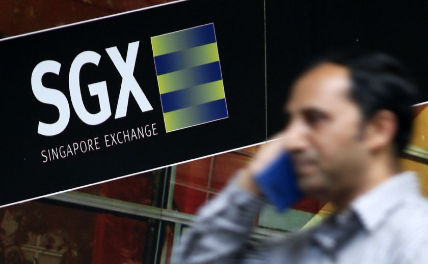 Singapore shares rose as much as 0.5 per cent, led by financial and telecom stocks. — Reuters pic