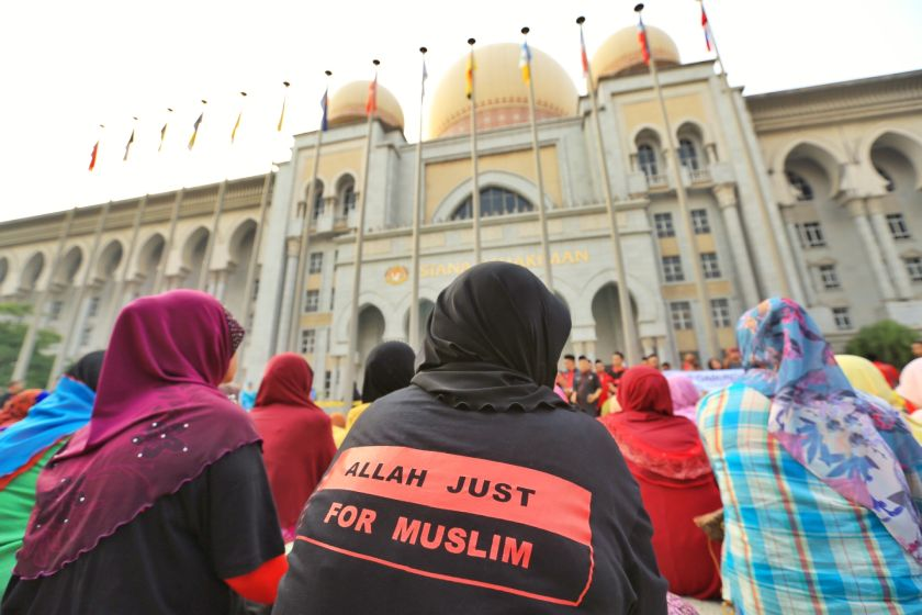 Muslim supporters gather in front of the Federal Court as they wait for the seven-member bench to decide on the appeal by the Catholic church against a lower court's decision forbidding it to use the word 'Allah' in its publication. — Picture by Saw Siow Feng