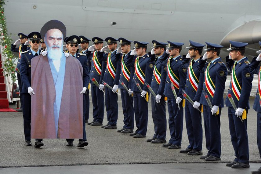 File picture shows Iranian air force soldiers carrying a cardboard cut-out of late founder of the Islamic Republic Ayatollah Khomeini, at Merhrabad airport, on February 1, 2012 during a ceremony to re-enact his arrival to Tehran in 1979. — AFP pic