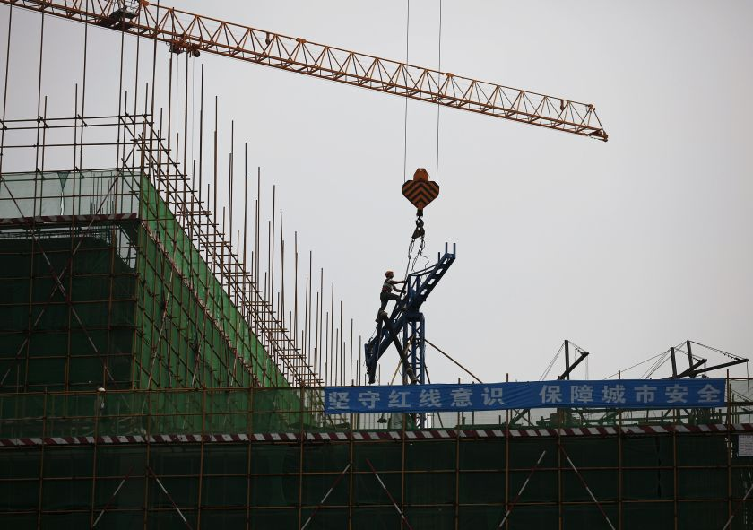 No one was injured in the crane collapse, according to police.  — Reuters pic