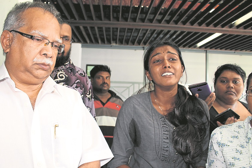 From left: Penang Deputy Chief Minister II P. Ramasamy and Regina Devi at the Seberang Jaya Hospital yesterday. Regina Devi claimed there were injuries on the body and legs of her deceased brother.