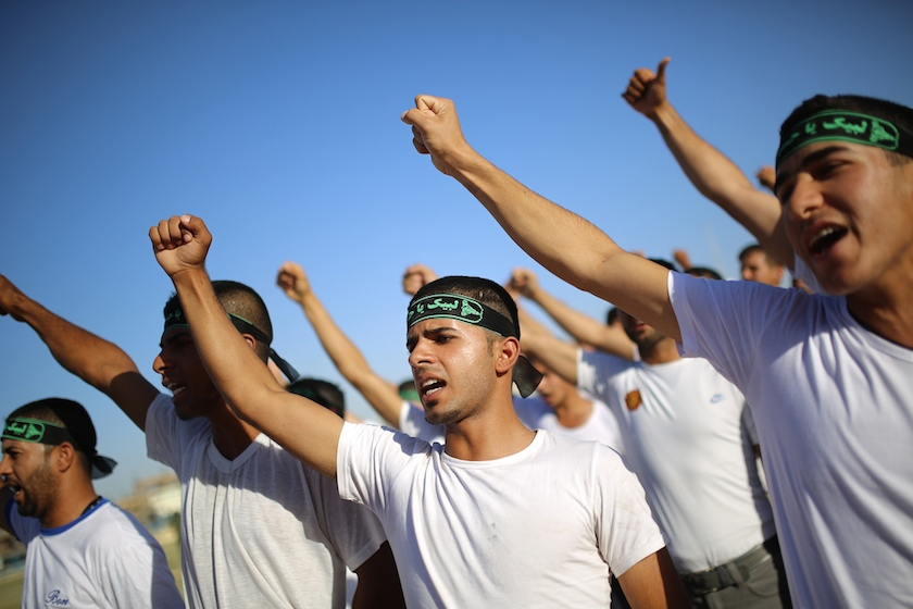 Shiite volunteers, who have joined the Iraqi army to fight against the predominantly Sunni militants from the radical Islamic State of Iraq and the Levant (ISIL), participate in military-style training in Najaf, June 23, 2014. — Reuters pic