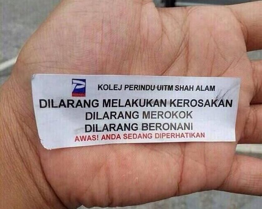 This white warning sticker bearing the name of Kolej Perindu has been circulated online, mostly in social media. ― Picture by Zurairi AR