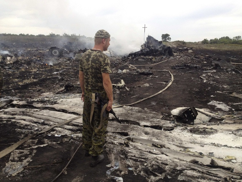 File photo of an armed pro-Russian separatist standing at a site of a Malaysia Airlines Boeing 777 plane crash in the settlement of Grabovo in the Donetsk region, July 17, 2014. — Reuters pic