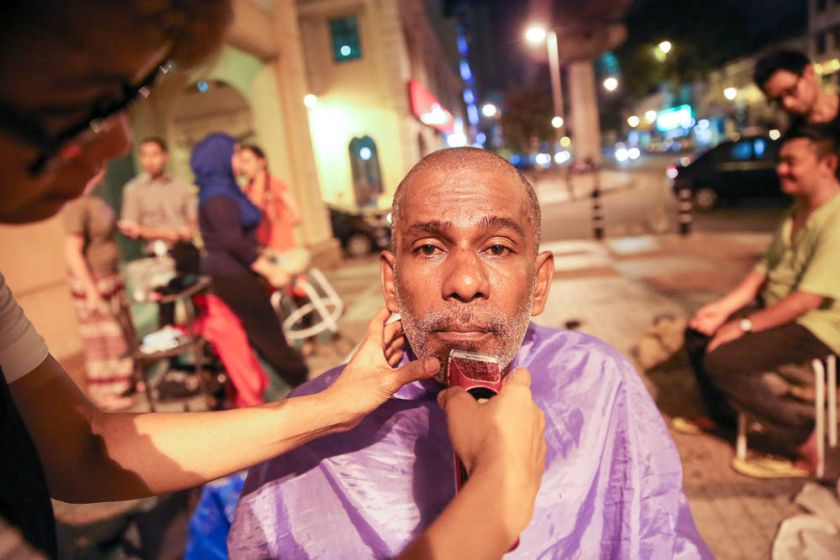 Kandasamy Muthuraman getting a free haircut at the Pertiwi soup kitchen, June 23, 2014. — Picture by Choo Choy May