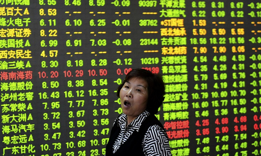 Individual investors in China are adding to their stock holdings, with some borrowing money to amplify their purchases on expectations the rally will continue. — Reuters pic