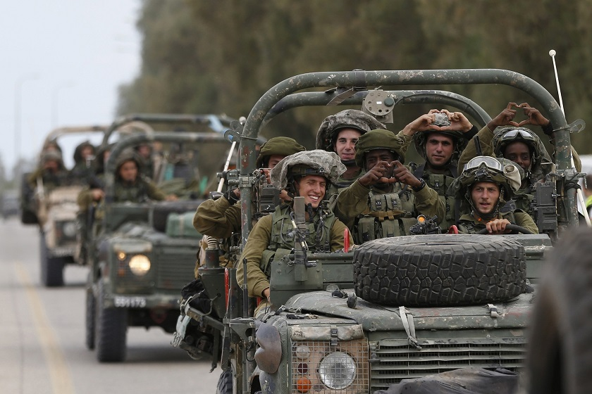 Israeli soldiers ride army jeeps near Sufa, outside the southern Gaza Strip July 17, 2014.— Reuters pic