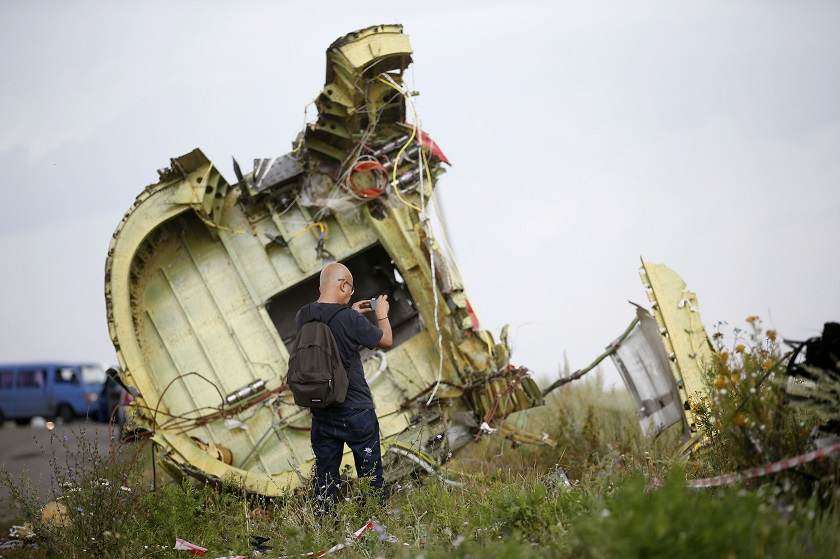 A Malaysian air crash investigator inspects the crash site of Malaysia Airlines Flight MH17, near the village of Hrabove (Grabovo), Donetsk region July 22, 2014. — Reuters pic