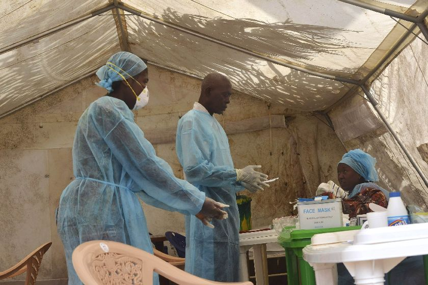 Health workers take blood samples for Ebola virus testing at a screening tent in the local government hospital in Kenema, Sierra Leone, June 30, 2014. ― Reuters pic