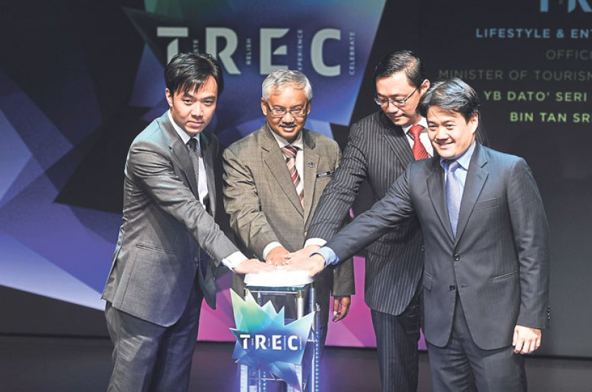 (From left) Ng, Tourism and Culture Malaysia deputy director-general Datuk Azizan Noordin, Tan and Cheng press a button to mark the launching of TREC. — Picture by Firdaus Latif.