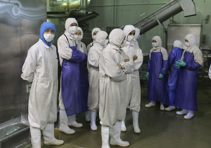 Employees stand during a seizure conducted by officers from the Shanghai Food and Drug Administration, at the Husi Food factory in Shanghai, July 20, 2014. China is embroiled in another food-related scandal as it seizes 12 tonnes of tainted yoghurt candy today. — Reuters pic