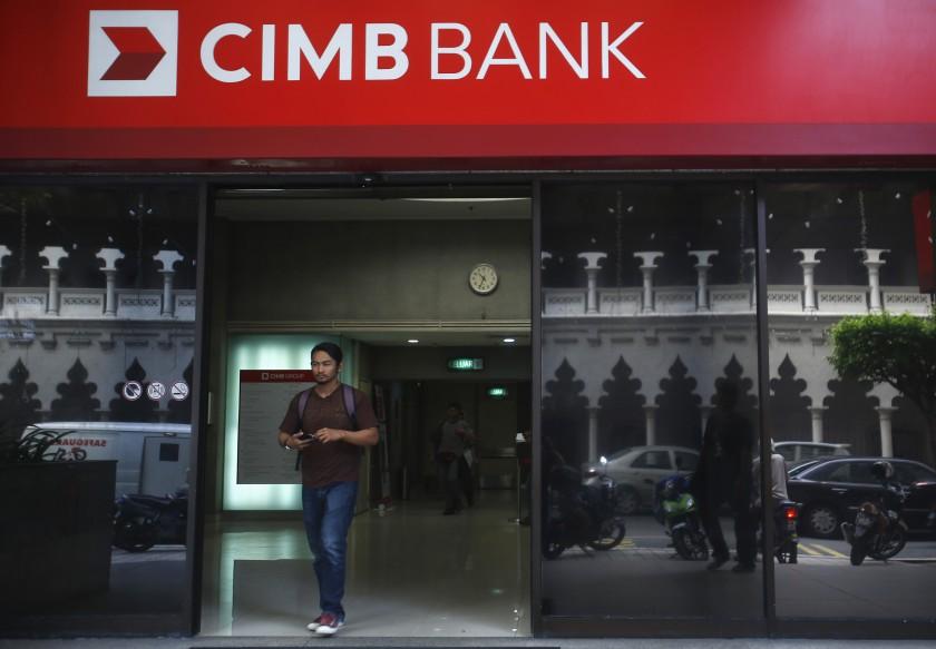 A man walks out of a CIMB Bank in Kuala Lumpur July 10, 2014. — Reuters pic