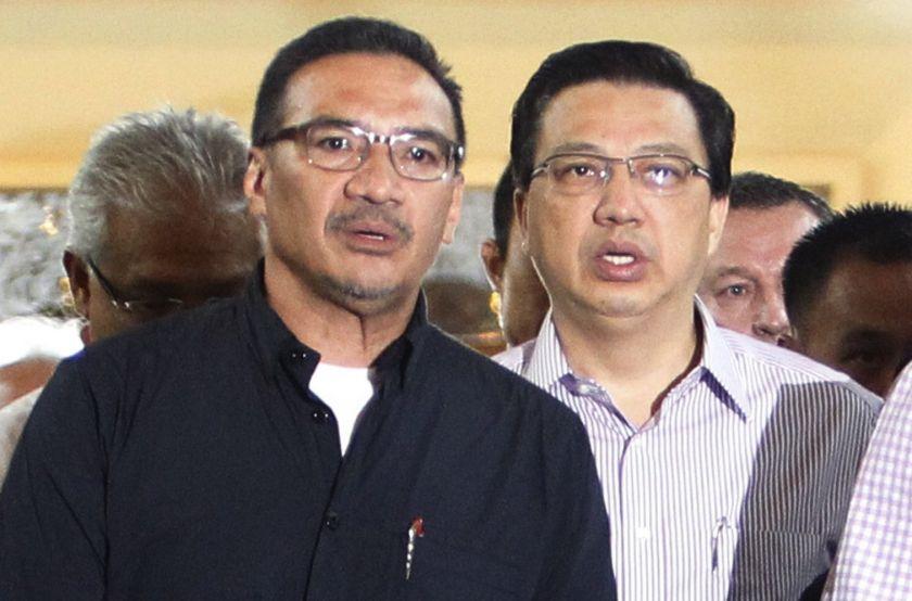 Malaysian Defense Minister Datuk Seri Hishammuddin Hussein (left) Transport Minister Datuk Seri Liow Tiong Lai for a meeting, at a hotel near the Kuala Lumpur International Airport in Sepang in this July 19, 2014. — Reuters pic