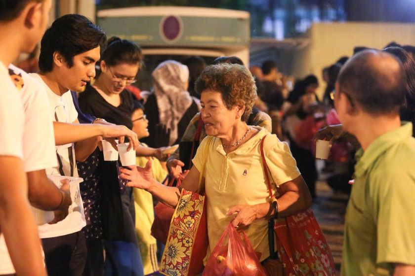 An elderly woman receives food given out by the Pertiwi soup kitchen at Jalan TAR, July 4, 2014. ― Picture by Choo Choy May