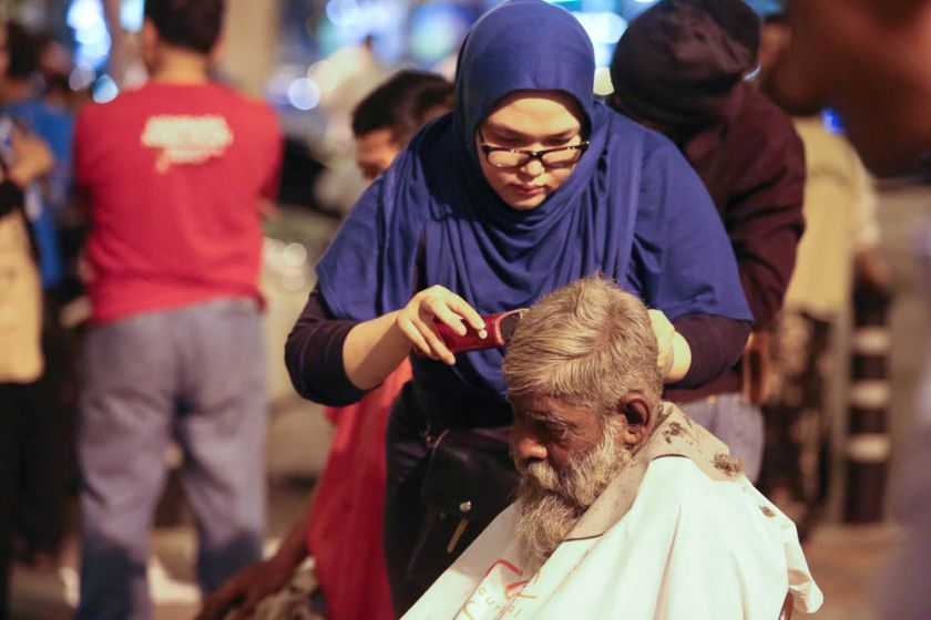 People get free haircuts at the Pertiwi soup kitchen, June 23, 2014. — PIcture by Choo Choy May