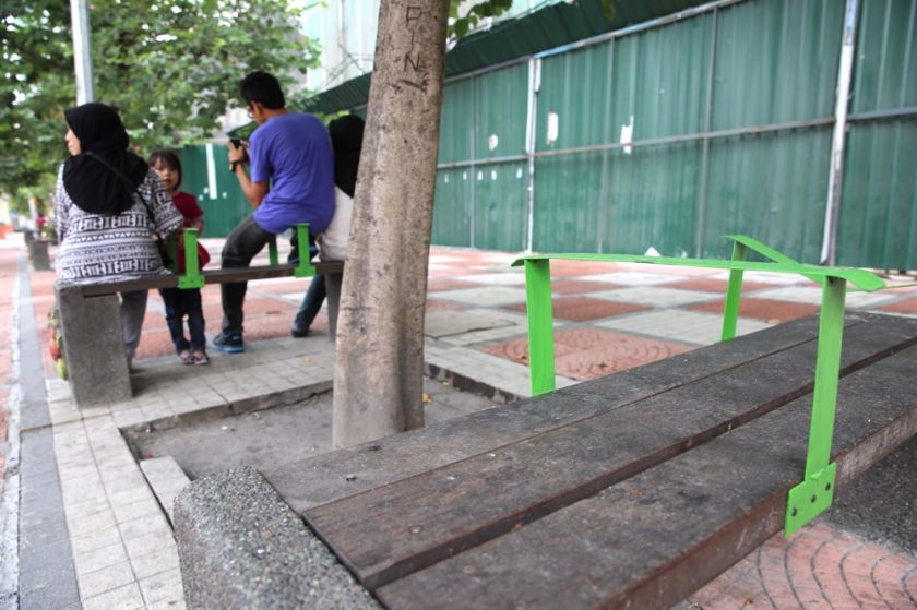 DBKL has installed handles on the benches along Jalan Tuanku Abdul Rahman to deter the homeless from sleeping on them. ― Picture by Choo Choy May