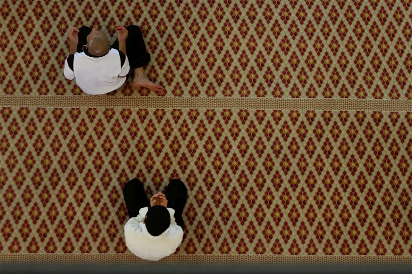 A man is seen reciting the doa after perform Friday prayers at the National Mosque in Kuala Lumpur, July 4, 2014. — Picture by Yusof Mat Isa