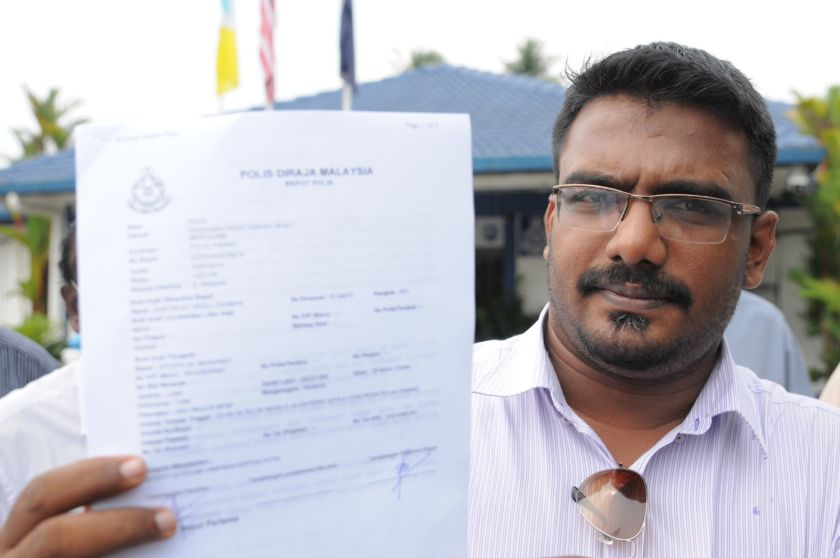 Seberang Perai municipal councillor Satees Muniandy lodged a police report this afternoon against Deputy Prime Minister Tan Sri Muhyiddin Yassin for allegedly using the May 13 tragedy to threaten Malaysian citizens. — Picture by K.E.Ooi