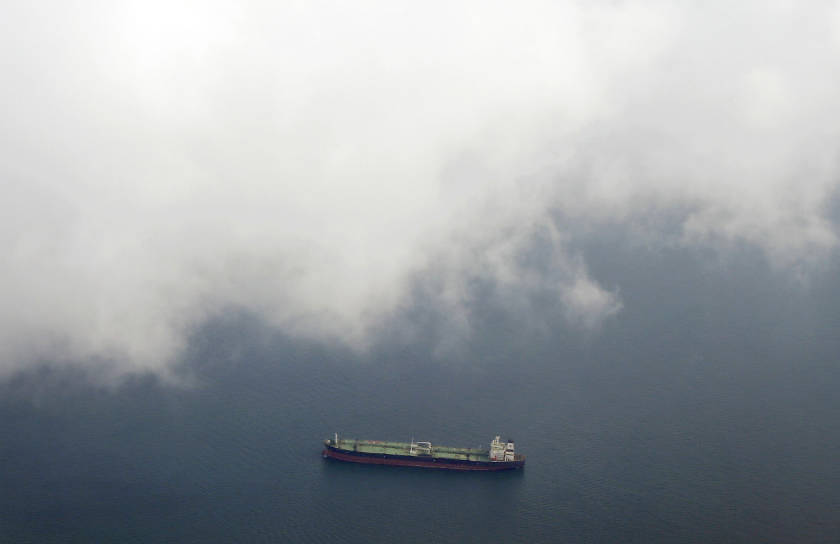 A tanker travels through the Singapore Strait July 7, 2014. Since April, at least six fuel tankers have been hijacked and drained in the Malacca Strait or nearby waters of the South China Sea, according to the International Maritime Bureau (IMB). — Reuters pic