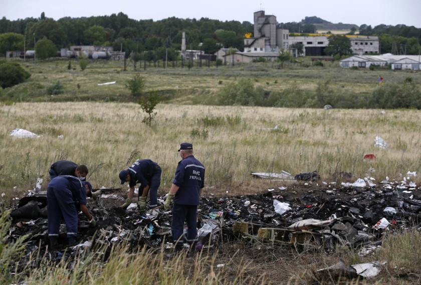 Members of the Ukrainian Emergencies Ministry work at a crash site of Malaysia Airlines Flight MH17, near the village of Hrabove, Donetsk region July 20, 2014. — Reuters pix