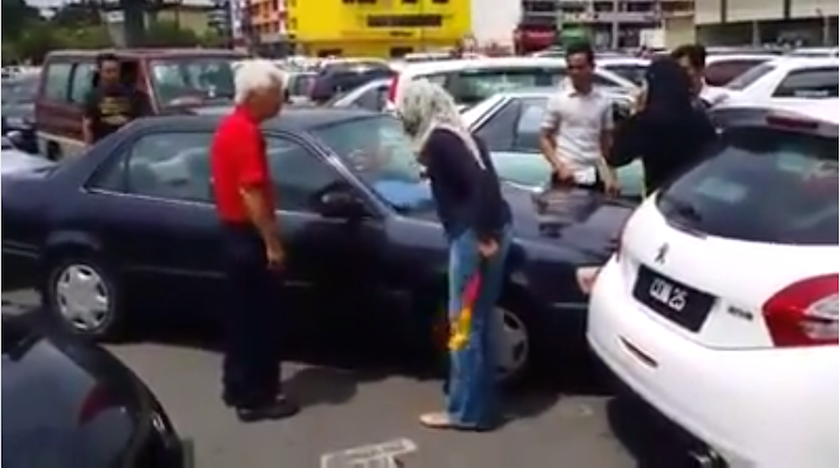 A screen grab of the video uploaded to YouTube yesterday in which a woman can be seen berating an elderly man for crashing into her car.