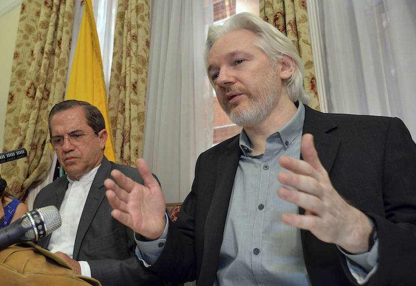 WikiLeaks founder Julian Assange  speaks as Ecuador's Foreign Affairs Minister Ricardo Patino listens, during a news conference at the Ecuadorian embassy in central London August 18, 2014. — Reuters pic
