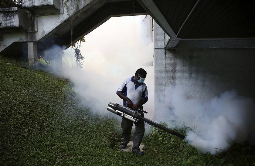 File control shows a worker spraying insecticide to help control the spread of dengue fever carried by mosquitoes in Kuala Lumpur. — Reuters pic