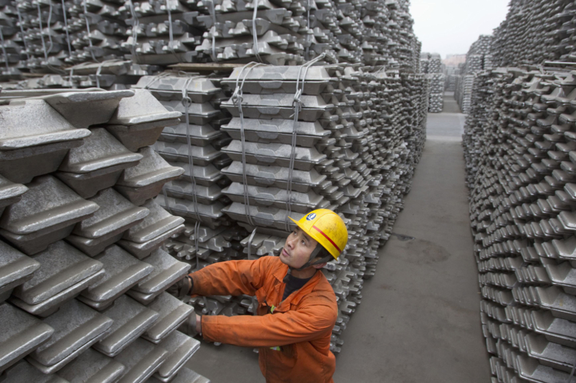 An employee checks aluminium ingots for export at Qingdao Port, Shandong province, in this March 14, 2010 file photo. — Reuters pic