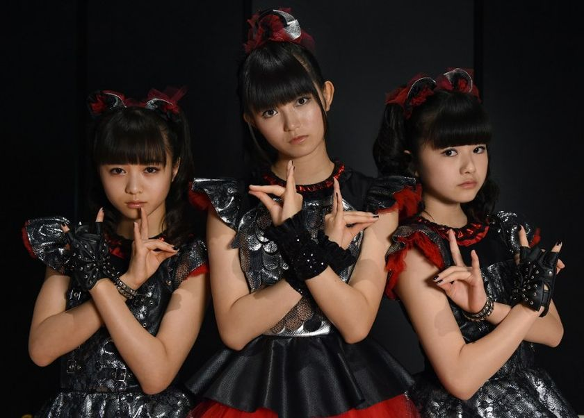 In this picture taken on August 16, 2014, members of Japan's pop group Babymetal, Moameta, Su-Metal and Yuimetal pose during an interview with Agence France-Presse (AFP) in Chiba, a suburb of Tokyo. — AFP pic
