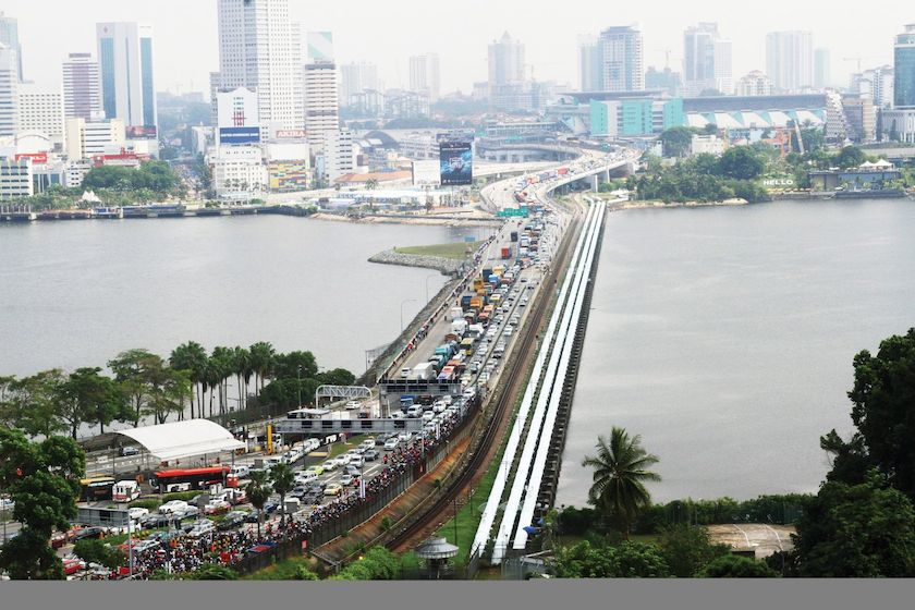 Despite protests by transport companies and frequent commuters of the Causeway, Malaysia raised the toll fees for cars leaving the country at its southern gateway in August with taxis paying RM8.20 for a round-trip while heavy good vehicles are charged RM33.30. — File pic