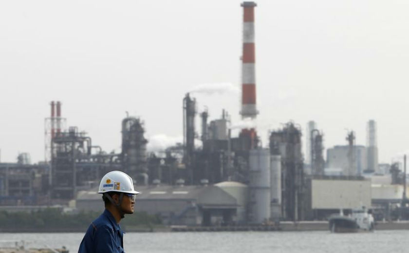 A worker is seen near a factory in Keihin industrial zone in Kawasaki, south of Tokyo, May 31, 2011. — Reuters pic
