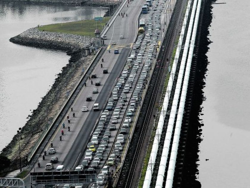 Despite protests by transport companies and frequent commuters of the Causeway, Malaysia raised the toll fees for vehicles leaving the country at its southern gateway in August with taxis paying RM8.20 for a round-trip while heavy good vehicles are charged RM33.30. — Today pic