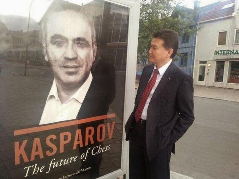 Kirsan Illyumshinov in front of a poster of Garry Kasparov.